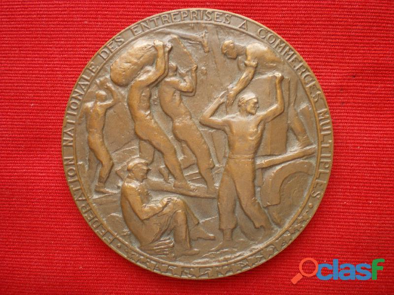 Médaille de la Fédération Nationale des Entreprises à Commerces Multiples.
