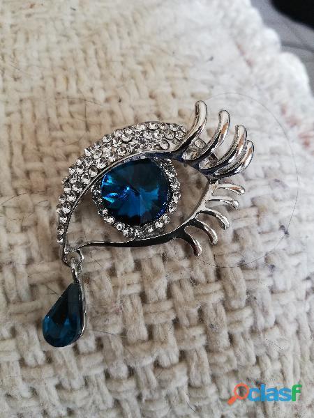 Broche œil bleu topaze et strass 4,5 cm état neuf