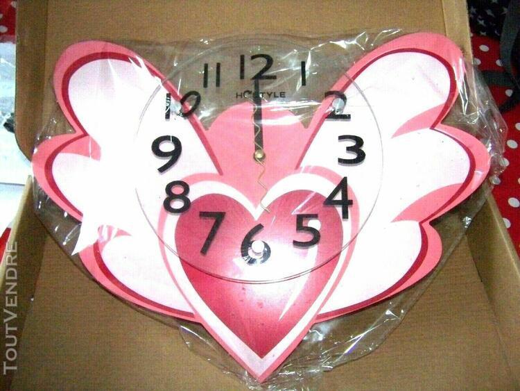 Horloge murale en bois rose