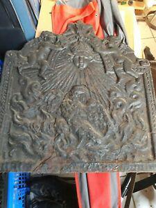 A vendre grande plaque de cheminée ancienne en fonte