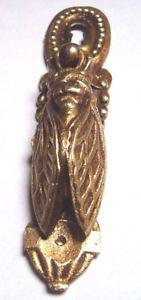Ancienne entree de serrure avec une cigale en bronze massive