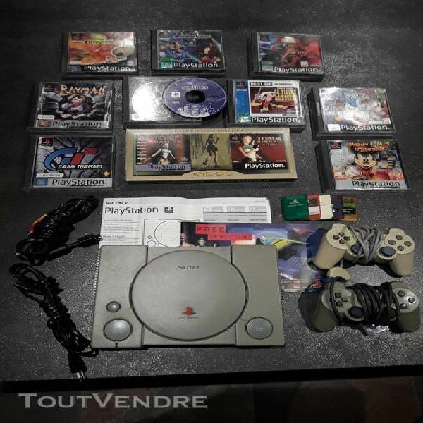 Console playstation avec 2 manettes, 5 mémoires et 10 jeux