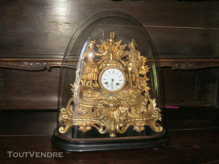 Pendule en régule cuivré avec son globe, époque 19ème.
