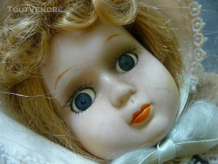 poupée vintage 40 cm tête et membresporcelaine corps en