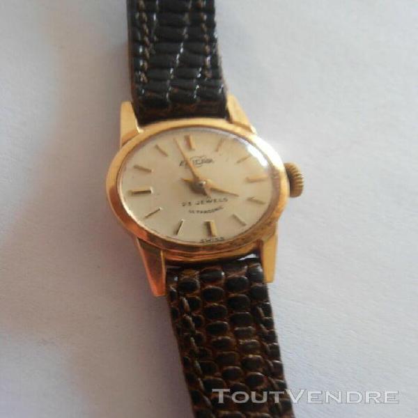 petite montre en or 18k mecanique annees 60 enicar femme gol