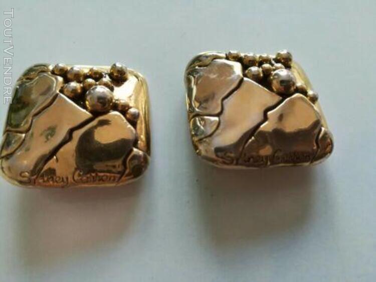 Boucle d'oreille a clips marque sidney caron en metal doré