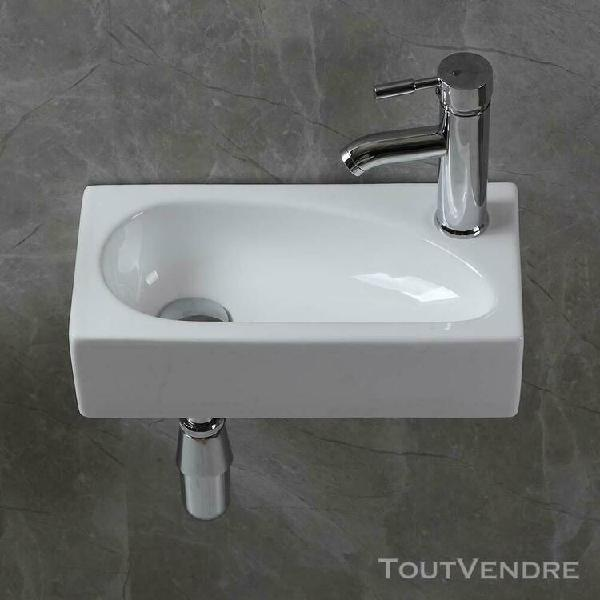 small cloakroom bathroom wash basin white ceramic sink wall