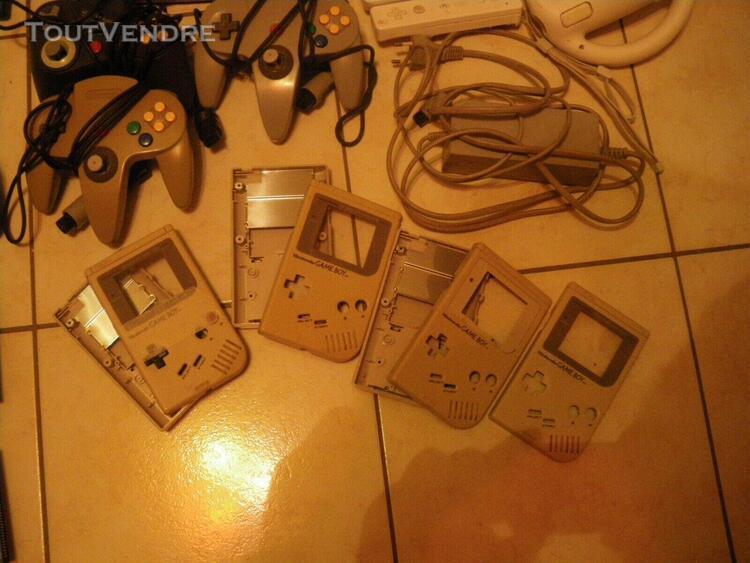 Lot de consoles manettes jeux cables coques nintendo semi hs