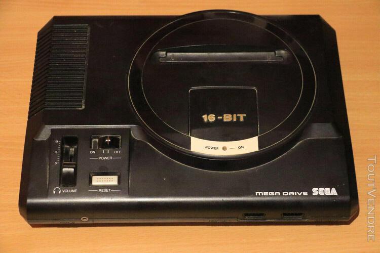 Mega drive + 4 jeux (world of illusion + fifa 95 96 97) + ma