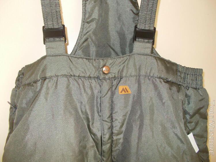 Combinaison hiver/ski couleur kaki avec bretelles en bon eta