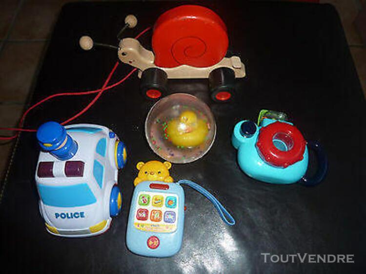 Lot de jouet bebe 1er age manipulation appareil photo balade