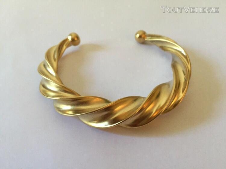 Nina ricci: bracelet torsade en plaqué doré