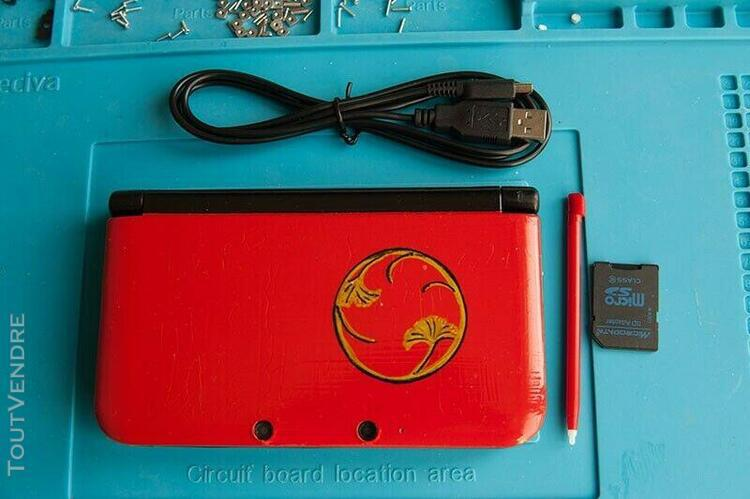 Nintendo 3ds xl rouge avec jeux.très bon état.