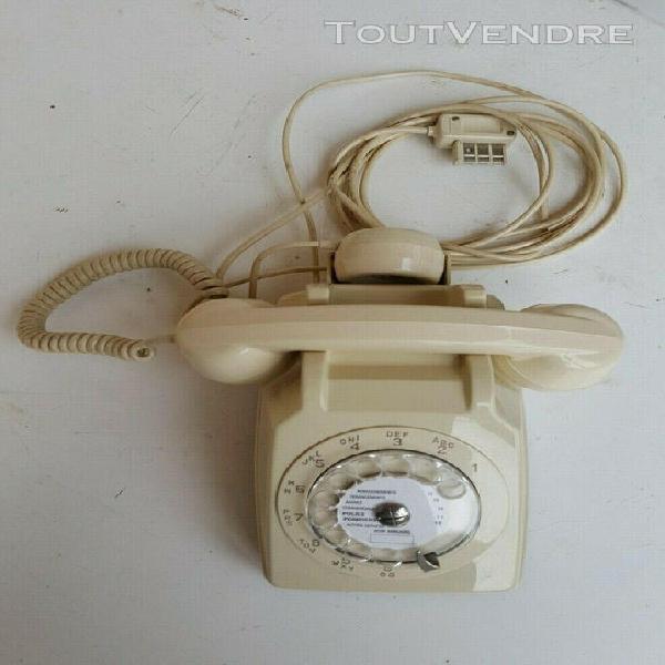 Ancien téléphone à cadran ivoire + ecouteur