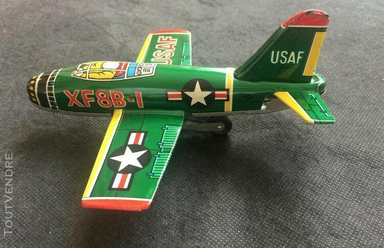 Ancien jouet avion en tôle lithographiée à friction