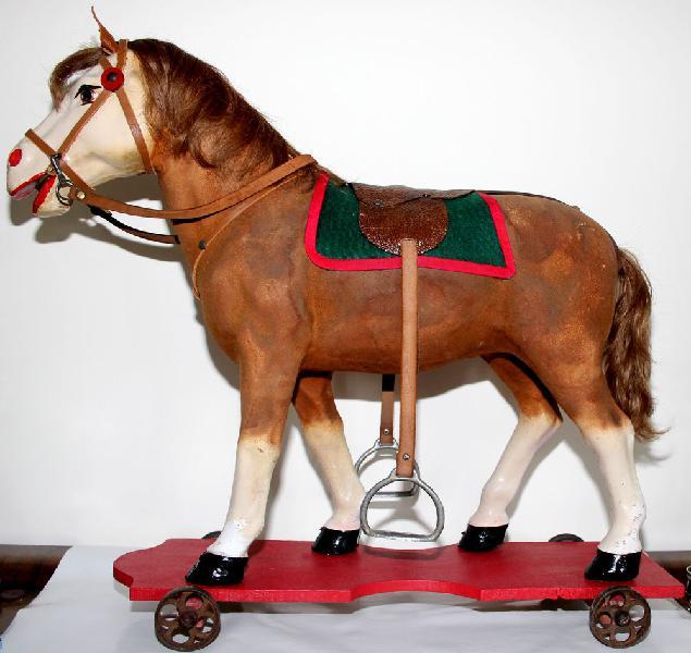 Grand cheval à roulettes papier maché occasion,
