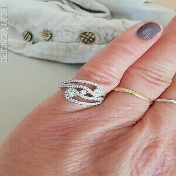 "Bague "" volute "" / diamants / or blanc 18 k / 18 carats / 75"