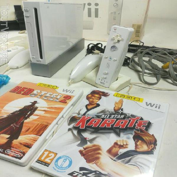 Nintendo wii + 2 manettes + 5 jeux + accessoires + sacoche +