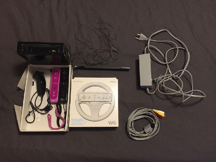 Wii + balance board + jeux + manettes + volant neuf, le