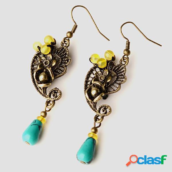 Boucles d'oreilles pendantes d'alliage vintage de palais de boucle d'oreille ethnique pour des boucles d'oreille d'alliage de bronzer de femmes