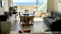Appartement au 2e étage superbe vue plage sud