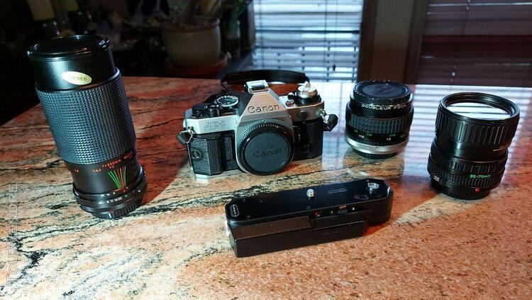 Canon ae-1 program + canon power winder a2 + 2 lens + starbl