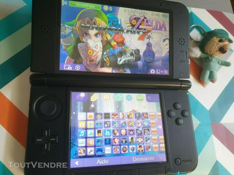 Nintendo 3ds xl 128 gigas /rouge noir/ 4000 jeux + chargeur